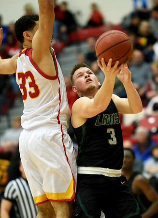 Missouri Southern's Parker Jennings (3) tries to score as Pittsburg State's Christian Edmondson (33) defends during their game on Saturday at John Lance Arena.<br /> Globe   Laurie SIsk