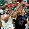 Missouri Southern's Enis Memic (12) draws a foul on Nebraska-Kearney's Kyle Juhl (32) during their game on Thursday night at Leggett & Platt.<br /> Globe | Laurie Sisk
