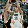 Missouri Southern's Cam Martin (31) shoots as Fort Hays State's Brady Werth, left and Kyler Kinnamon, right, defend during their game on Saturday at Leggett & Platt.<br /> Globe | Laurie Sisk