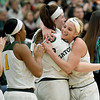 From the left: Missouri Southern players Morgan Brightwell, Destiny Cozart and Jordan Schoenberger hug teammate Chelsey Henry after Henry leaves the court following the last home game of her career on Tuesday night at Leggett & Platt.<br /> Globe | Laurie SIsk