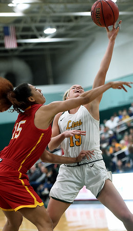 Missouri Southern's Chelsey Henry puts up a shot as Pittsburg State's Athena Alvarado defends during their game on Tuesday night at Leggett & Platt.<br /> Globe | Laurie SIsk