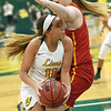 Missouri Southern's Amber Buch (11) tries to get past Pittsburg State's Megan Scott during their game on Tuesday night at Leggett & Platt.<br /> Globe | Laurie Sisk