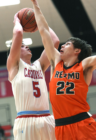Webb City's Alex Gaskill (5) puts up a shot as Republic's Broc Smith (22) defends during their game on Friday night at Webb City High School.<br /> Globe | Laurie SIsk