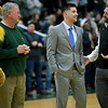 "Missouri Southern basketball coach Jeff Boschee, second from the right, is recognized on Tuesday night at Leggett & Platt. Joing Boschee from the left: MSSU mascot ""Roary"" the Lion, former coach Robert Corn and MSSU Director of Athletics Jared Bruggeman.<br /> Globe 