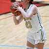 Neosho's Olivia Hixson (23) hits a long 3-pointer during Neosho's Class 4 District 12 game against McDonald County on Saturday at Webb City High School.<br /> Globe | Laurie Sisk