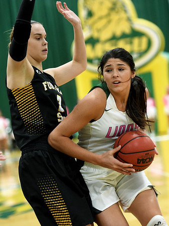 Missouri Southern's Layne Skyles (5) tries to get past Fort Hays State's Lanie Page (3) during their game on Saturday at Leggett & Platt.<br /> Globe | Laurie Sisk