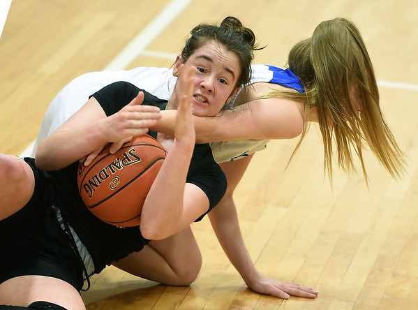 College Heights' Emmy Colin signals for a timeout as McAuley's Taylor Schiefelbein tries to tie up the ball during their game on Friday night at McAuley.<br /> Globe | Laurie Sisk