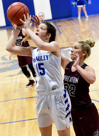 McAuley's Kennedy DeRuy (15) gets past Wheaton's Hallie Mitchell (32) for a shot during their championship game of the Warrior Classic on Saturday at McAuley High School. Globe | Laurie Sisk
