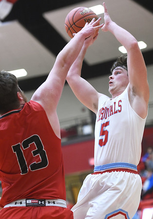 Webb City's Alex Gaskill (5) shoots over McDonald County's Cooper Reece (13) during their semifinal game of the Class 4 District 12 tournament on Wednesday night at Webb City High School.<br /> Globe | Laurie Sisk