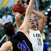 Missouri Southern's Kinzer Lambert (11) shoots over Nebraska-Kearney's Weston Bake Magrath (24) during their game on Thursday night at Leggett & Platt.<br /> Globe | Laurie Sisk