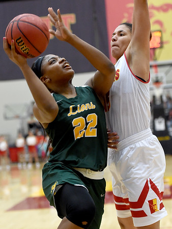 Missouri Southern's Chasidee Owens (22) tries to score as Pittsburg State's Athena Alvarado (15) defends during their game on Saturday at John Lance Arena.<br /> Globe | Laurie SIsk
