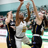 Missouri Southern's Chasidee Owens (22) tries to split Nebraska-Kearney defenders Elisa Backes (5) and Shiloh McCool (25) during their game on Thursday night at Leggett & Platt.<br /> Globe | Laurie Sisk