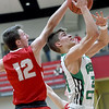 Liberal's Toby Dingman (12) blocks a shot by Pierce City's Kyle Renkoski (24) during their Class 2 District 12 semifinal game on Thursday night at Webb City High School.<br /> Globe | Laurie Sisk