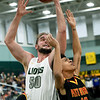 Missouri Southern's Ted Brown (50) battles Pittsburg State's R.J. Lawrence (10) for a rebound  during their game on Tuesday night at Leggett & Platt.<br /> Globe | Laurie Sisk