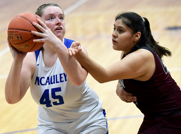 McAuley's XXXX XXXX (45) looks to score as Wheaton's Giovanna Hinojosa defends during their championship game of the Warrior Classic on Saturday at McAuley High School. Globe | Laurie Sisk