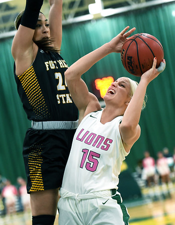 Missouri Southern's Chelsey Henry (15) challenges Fort Hays State's Tatyana Legette (24) during their game on Saturday at Leggett & Platt.<br /> Globe | Laurie Sisk