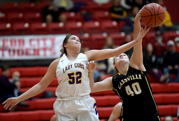 Monett's Abigail Patton (52) and Cassville's Lilly Harrison (40) battle for a rebound during their Class 4 District 12 game on Saturday at Webb City High School.<br /> Globe | Laurie Sisk