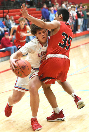 Webb City's Nickhai Howard (21) draws a foul on McDonald County's Saul Garcia (35) during their semifinal game of the Class 4 District 12 tournament on Wednesday night at Webb City High School.<br /> Globe | Laurie Sisk