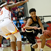 Missouri Southern's Reggie Tharp (0) drives the baseline as Pittsburg State's Donovan Franklin (3) defends during their game on Saturday at John Lance Arena.<br /> Globe | Laurie SIsk