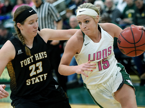 Missouri Southern's Chelsey Henry (15) tries to drive past Fort Hays State's Kacey Kennett (23) during their game on Saturday at Leggett & Platt.<br /> Globe | Laurie Sisk