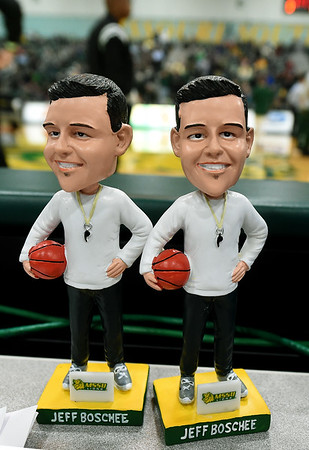 A duo of Jeff Boschee bobbleheads sit on a press table on Tuesday night at Leggett & Platt.<br /> Globe | Laurie Sisk