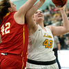 Missouri Southern's Jordan Schoenberger, right,  puts up a shot as Pittsburg State's Megan Scott defends during their game on Tuesday night at Leggett & Platt.<br /> Globe | Laurie Sisk