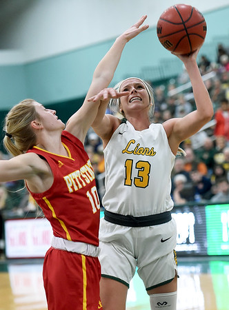 Missouri Southern's Brooke Stauffer (13) puts up a shot as Pittsburg State's Tristen Gegg (10) defends during their game on Tuesday night at Leggett & Platt.<br /> Globe | Laurie Sisk