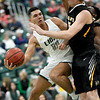 Missouri Southern's Kinzer Lambert (11) dishes off to a teammatet as Fort Hays State's Brady Werth (25) defends during their game on Saturday at Leggett & Platt.<br /> Globe | Laurie Sisk