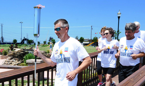 Globe/T. Rob Brown<br /> Todd Gardner of Springfield leads the pack of Torch Run participants in support of the Show Me State Games Wednesday afternoon, June 26, 2013, during an event at Cunningham Park in Joplin.