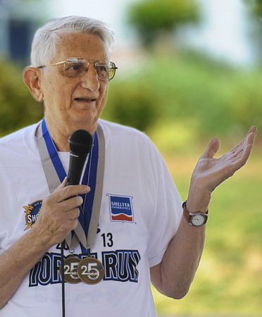 Globe/T. Rob Brown<br /> Dave McCoy, 81, of Carthage, talks about the Torch Run and the Show Me State Games Wednesday afternoon, June 26, 2013, during an event at Cunningham Park in Joplin.