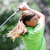 Globe/T. Rob Brown<br /> Heather Parrish of Baxter Springs, Kan., part of the Joplin area team, tees off Tuesday morning, June 18, 2013, during the Horton Smith women's golf tournament at Briarbrook Country Club in Carl Junction.
