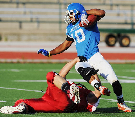 Globe/Roger Nomer<br /> Joplin's Justin Williams brings down Northern Oklahoma's Ky'Ale Lloyd on a return during Saturday's game at Fred G. Hughes Stadium.