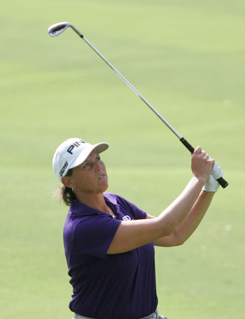 Globe/Roger Nomer<br /> Wendy Ward watches her chip shot during play at Eagle Creek Golf Course on Monday.