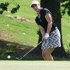Globe/Roger Nomer<br /> Paige MacKenzie chips onto the green at Eagle Creek on Monday morning.