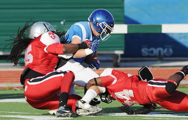 Globe/Roger Nomer<br /> Joplin's Antwan Dyer, left, and Isaac White team up to stop Northern Oklahoma's Aaron Atkinson during Saturday's game at Fred G. Hughes Stadium.