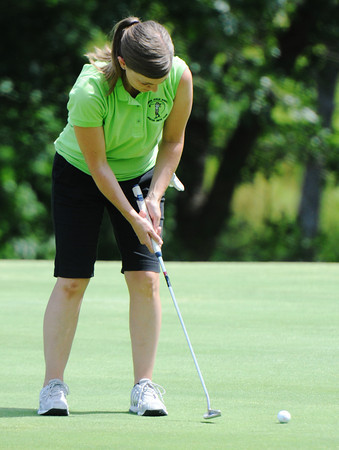Globe/T. Rob Brown<br /> Heather Parrish of Baxter Springs, Kan., part of the Joplin area team, putts Tuesday morning, June 18, 2013, during the Horton Smith women's golf tournament at Briarbrook Country Club in Carl Junction.