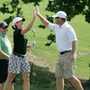 Globe/Roger Nomer<br /> Paige MacKenzie high fives John Troutman, Kansas City, Mo., after holing a chip shot at Eagle Creek on Monday.