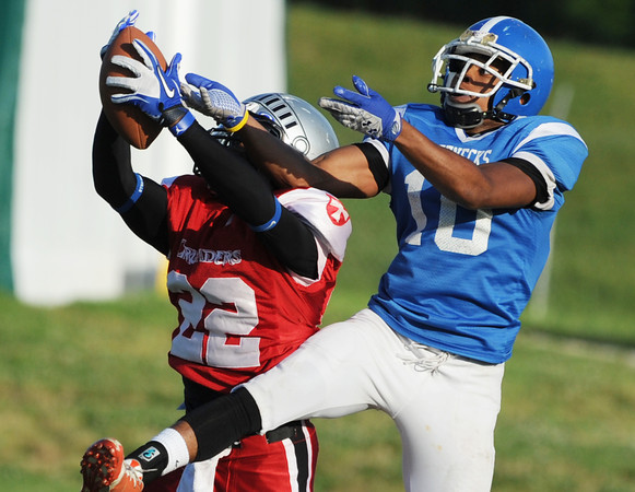 Globe/Roger Nomer<br /> Joplin's Blu Cato pulls down an interception from North Oklahoma's Ky'Aale Lloyd in the first quarter of Saturday's game at Fred G. Hughes Stadium.