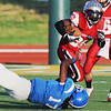 Globe/Roger Nomer<br /> Joplin's Kenny Ray Session Jr. escapes a tackle from Northern Oklahoma's Garehtte Casper during Saturday's game at Fred G. Hughes Stadium.