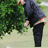 Globe/Roger Nomer<br /> Becky Bruder, Joplin, chips onto the green while competing in Monday's Horton Smith Tournament in Carthage.