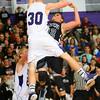 Northwestern's Trenton Brazel fouls Western's Evan Balentine who was going up for a shot.<br /> KT photo | Tim Bath