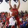 11-21-12<br /> KHS vs WHS boys basketball<br /> Dylan Orbaugh (left) and Erik Bowen of Kokomo High School tries to block Des Balentine's shot for Western during the first half of the basketball game on Wednesday.<br /> KT photo | Kelly Lafferty