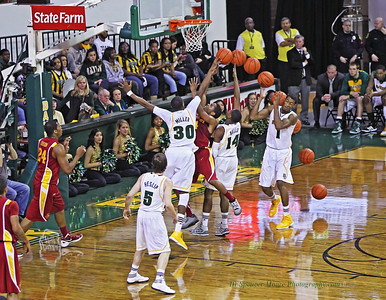 A great blocked shot by Quincy Miller for Baylor. He blocked the shot so hard it almost hit Perry Jones III in the face. You can see the track of the ball as it hits the floor.