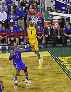 Perry Jones III finishing the slam-dunk successfully.