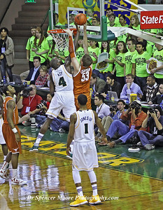 Quincy Acy goes up for a successful inside blocked shot against UT.