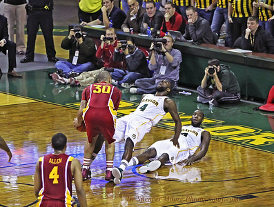 Quincy Acy establishes a legal position in the lane and gets a charging foul from the Iowa State player. Nice defensive play.