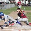 Action during the Odessa-Montour vs. Candor baseball game, April 15, 2015.