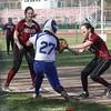 Action during the Odessa-Montour vs. Candor softball game, April 15, 2015.