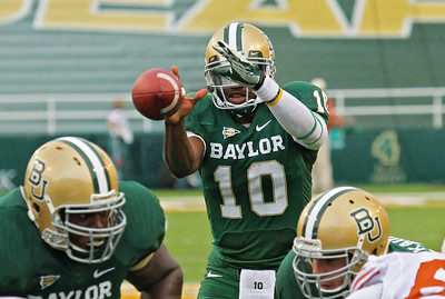 Heisman Trophy Winner, RG III taking a snap from the center late in the Texas game. Nothing unusual except we are hoping this isn't one of the last snaps we see him take from the field at Baylor Stadium. You know?