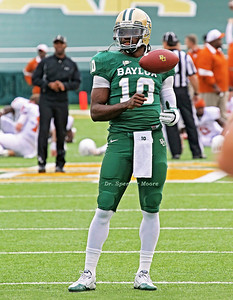 Heisman Trophy winner, Robert Griffin III was preparing for the afternoon game against Texas and I caught him in deep thought as he was contemplating the event. He often bounces the ball off of his fist and catches it while gazing off at the other players on the field. It happened to be the perfect moment when the ball was just right in it's bounce for the BU logo to be lined up perfectly in mid-air. @Dr. Spencer Moore Photography